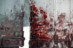 Bloody hand prints - The Walking Dead _ Season 6, Episode 1 _ BTS - Photo Credit: Gene Page/AMC